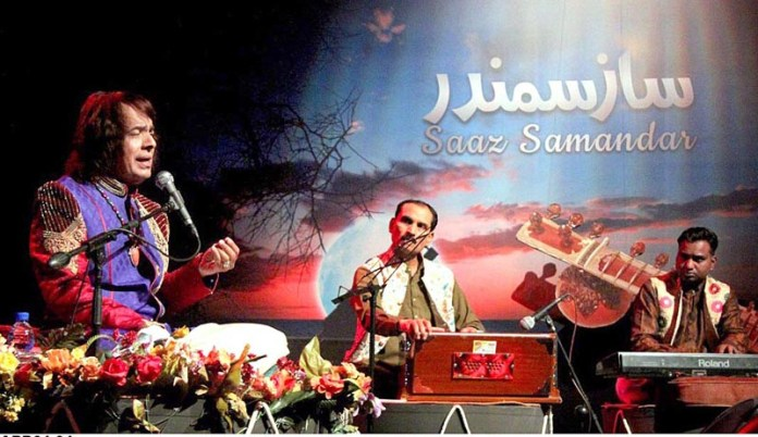 ISLAMABAD: November 04 - Legendary tabla player of Subcontinent Ustad Abdul Sattar Tari Khan performing on the stage during a function titled