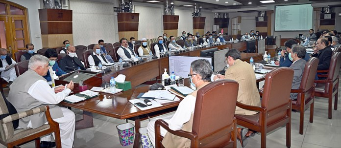 PESHAWAR: November 10 - Chief Minister Khyber Pakhtunkhwa Mahmood Khan presiding over a meeting of Provincial Cabinet at Civil Secretariat. APP