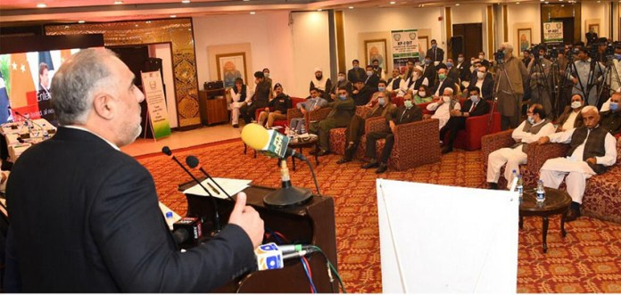Speaker NA Asad Qaider addressing a seminar in Peshawar