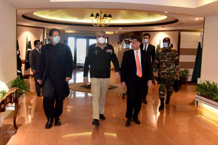 DG ISI General Faiz Hamid escorts Prime Minister Imran Khan along with Chief of Army Staff General Qamar Javed Bajwa during their visit to the ISI Hqs.