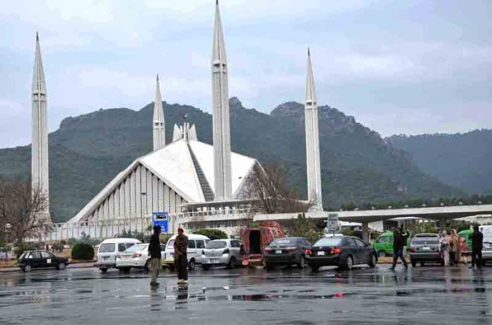 An attractive view of Shah Faisal Mosque during light rain in the federal capital