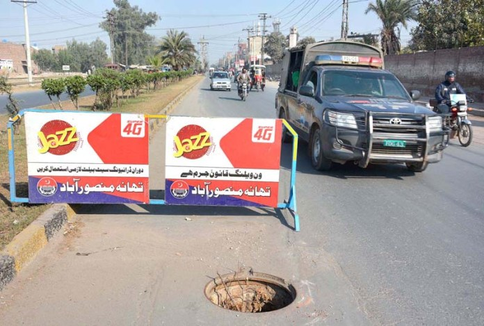 A view of open PTCL main-hole in the middle of Jhumra Road near WAPDA Colony may cause any mishap and needs the attention of concerned authorities