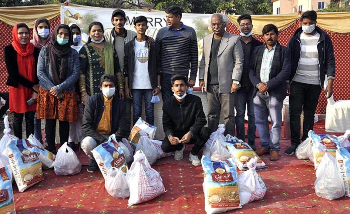 Director Youth Development Association Ms. Rubina Bhatti in a group photo after distribution of food hampers among 150 deserving families at G-7 Kachi Abadi