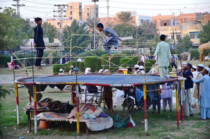 Children enjoying on jumping jack at Latifabad
