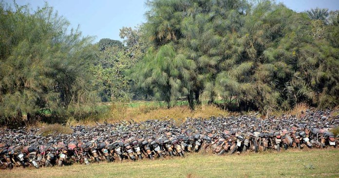 A large number of seized motorcycles parked in an open area in a miserable condition at Samanabad Police Station and needs the attention of concerned authorities