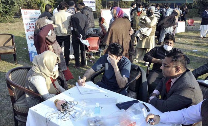 Doctors examining the patients during free medical camp at National Press Club