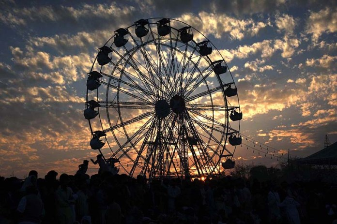 An eye catching view of swing on late evening time in front of Peer Mian Lal shrine during annual Urs celebrations near Fatehpur Mirani Village