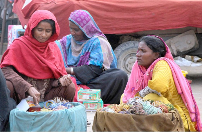 - Vendors waiting for the customer to sell bangles at their roadside setup