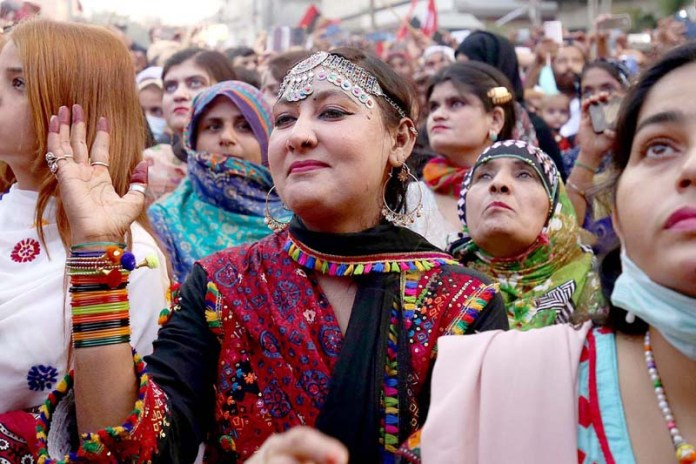 Women enjoying musical programme in front of Press Club on Sindhi Cultural day which is celebrating each year on first Sunday (First week) of December