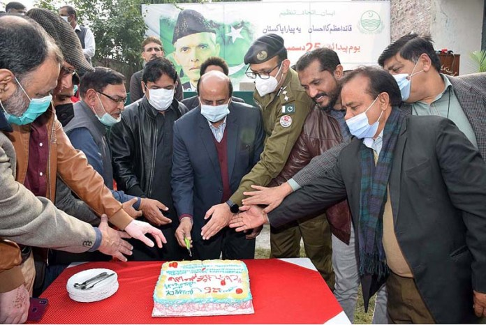 Punjab Minister for Special Education Ch. Muhammad Akhlaq cutting the cake during a function mark the birth anniversary of Quaid-e-Azam Muhammad Ali Jinnah