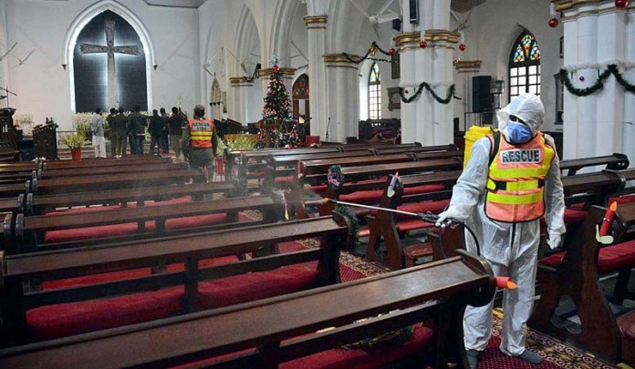 Rescue-1122 staffers spraying disinfectants being carried out at Saint John's Cathedral Church as precautionary measures against corona virus during preparation of Christmas celebrations