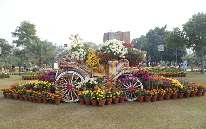 The buggy is decorated with beautiful flowers at a flower show at Race Course Park