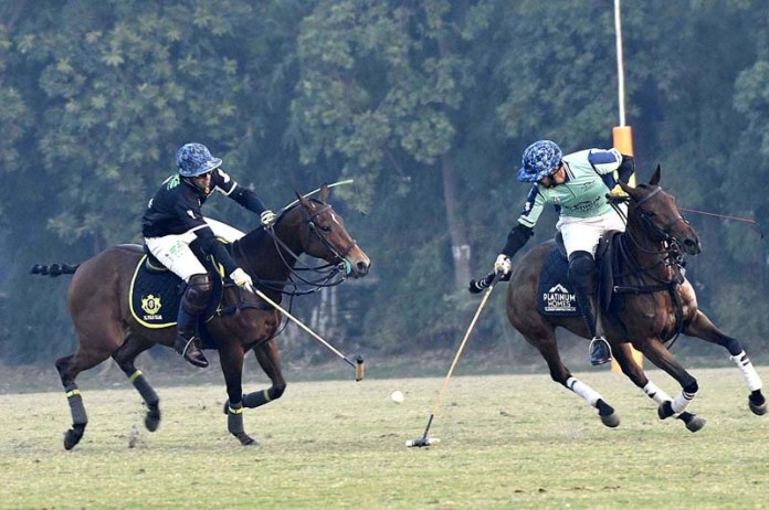 Players struggling to get hold on the ball during Hamadan Polo for The Lahore Open Polo Championship 2020 in the first match between FG Polo and Monnoo Polo teams at Aibak Polo ground