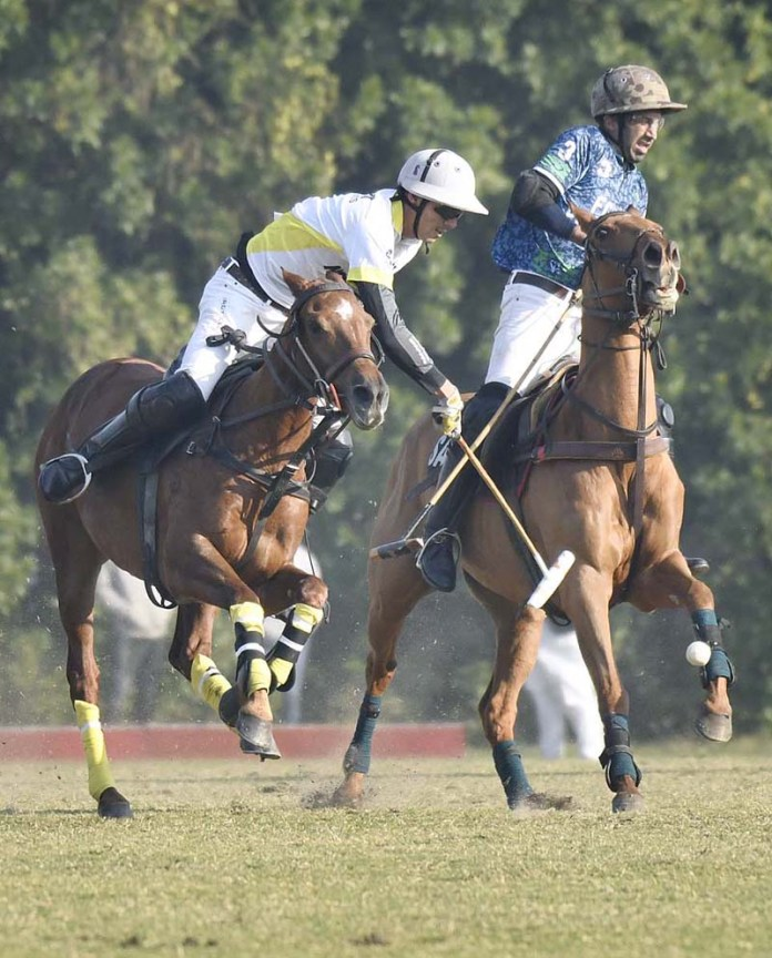 Players struggling to get hold on the ball in first semifinal match played between Master Paints and Diamond Paints / FG polo teams during Hamadan Polo for the Lahore Open Polo Championship 2020. Master paints won by 8-7