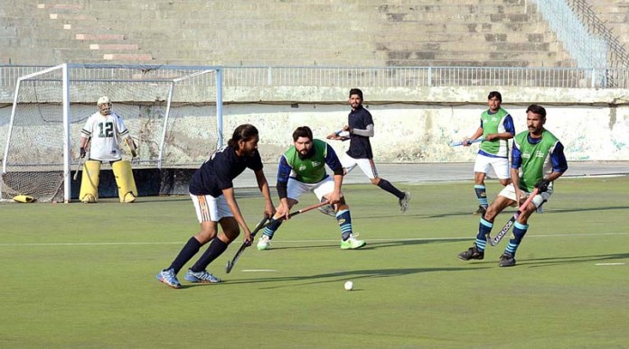 Players of Faisalabad Hockey and Chiniot Hockey teams struggling to get hold on the ball during Inter District Hockey Championship 2020 played at Hockey Stadium organized by Sports Department