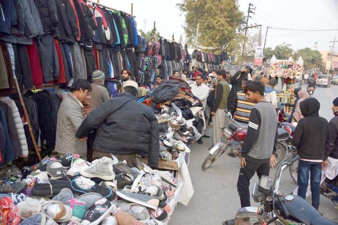 People purchasing second hand clothes in preparation of winter season