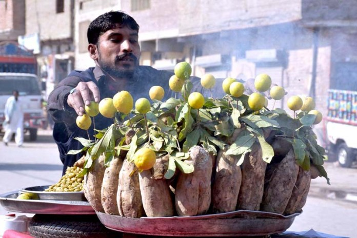 A vendor selling traditional food items at old Fish Market Road