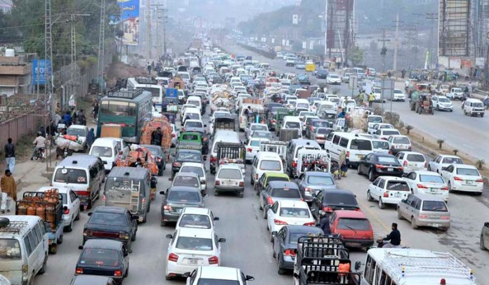 A view of heavy traffic jam as work on expanding a bridge going on near Lahore High Court Rawalpindi Bench in the outskirts of the city