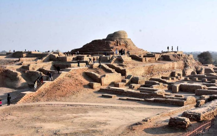 People visiting world's historical place Mohenjo-Daro (Mound of dead) remains of the most impressive city of the Indus Valley Civilization, located 28 kilometers south of Larkana in Sindh