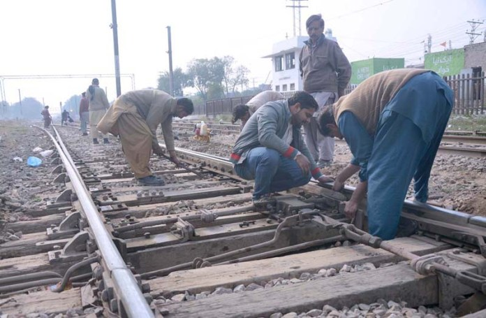 Railway staffers busy in maintenance work of rail track