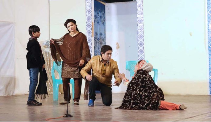 "Artists performing on the stage during a drama titled ""Kachay Dhagay"" at Multan Arts Council"