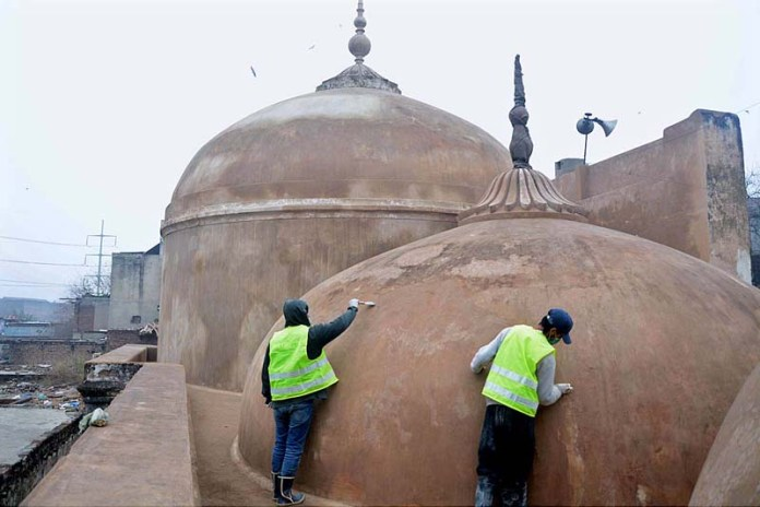Labourers busy in renovation work of Masjid of Mariyam Zamani Begum, it is an early 17th-century mosque situated in the City Lahore, Pakistan. The mosque was built between 1611 and 1614 during the reign of Mughal Emperor Jahangir in honour of his mother