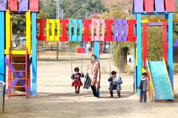 Children enjoying swing at National Ayub Park in the city