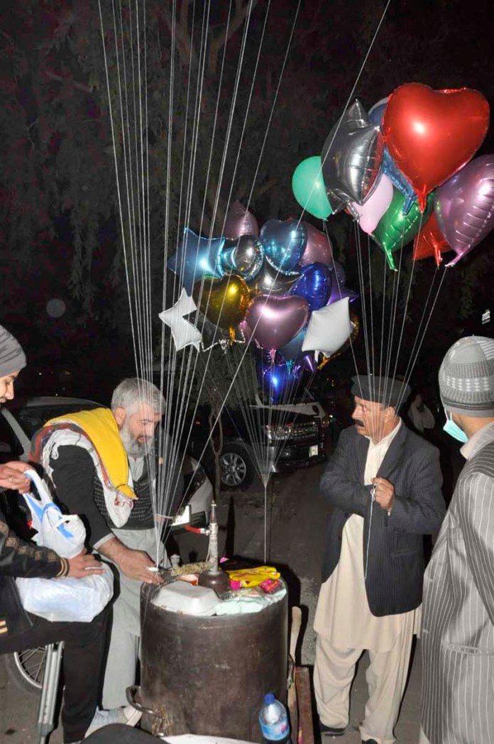 An aged handicap person selling balloons to earn for livelihood in the federal capital