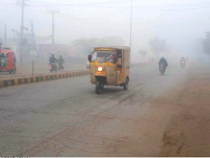 Vehicles on the way during thick fog that engulfs the city during morning time