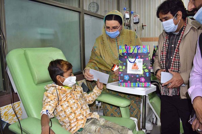 Special Assistant to Chief Minister Punjab Dr. Firdous Ashiq Awan distributing gifts among the Hemophilia - Thalassemia patients at Sundas Foundation