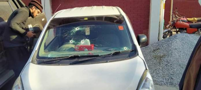 Shattered windscreen of Usama's car. Police said they fired while chasing the car.