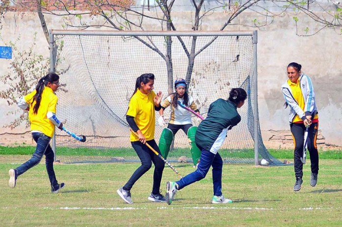 Players of Govt Women College Burewala and Govt Women College Mumtazabad struggling to get hold on the ball during Inter Collegiate Hockey Championship 2021 played at BISE Ground