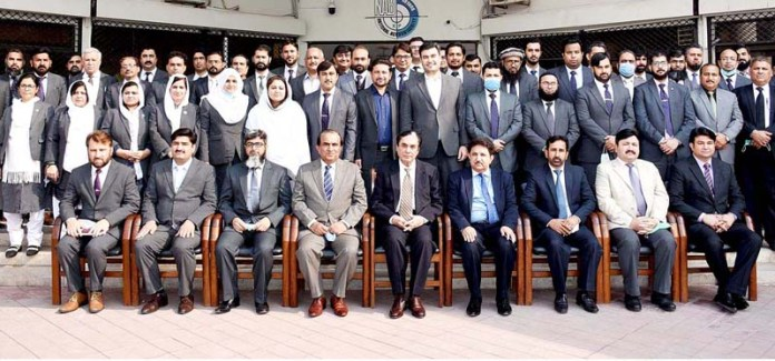 Chairman NAB, Justice (Retd) Javed Iqbal and DG NAB KP Brig (R) Farooq Naser Awan pose for a group photo with NAB officers after a meeting at NAB KP