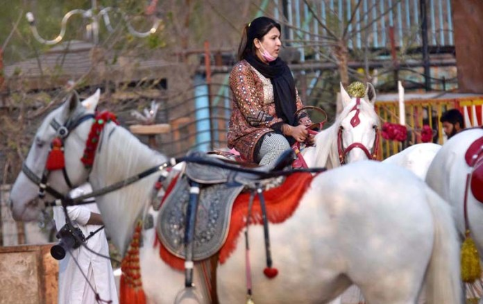 A woman enjoying horse ride at Lake View Point in Federal Capital