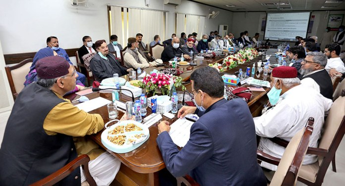 Federal Minister For Planning, Development, Reforms and Special Initiatives Asad Umar presiding a high-level meeting with HESO official along with MNAs, MPAs and PTI leaders at HESCO chief office