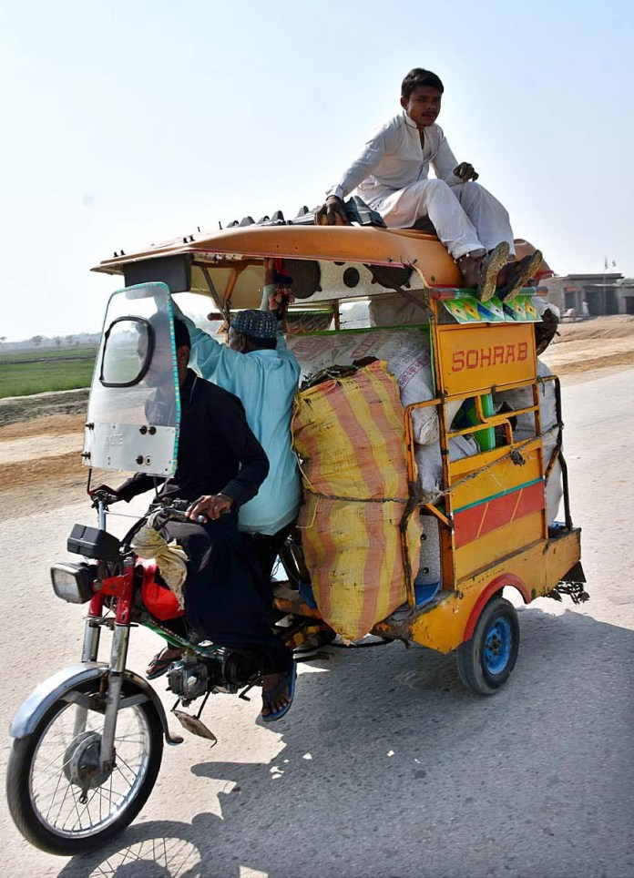 A person traveling on the rooftop of tri-cycle rickshaw at Rasheed Wagan Village Road may cause any mishap