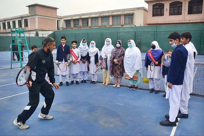 Trainer is giving training to children and students during Junior Tennis Initiative (JTI) program in collaboration with International Tennis Federation (ITF) and Pakistan Tennis Federation (PTF) to promote tennis in Pakistan at Tennis Club