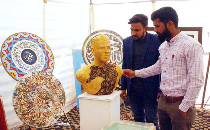 Visitors viewing the displayed stuff during Cholistan Trade Festival at Derawar Fort on the occasion of 15th TDCP Cholistan Desert Jeep Rally