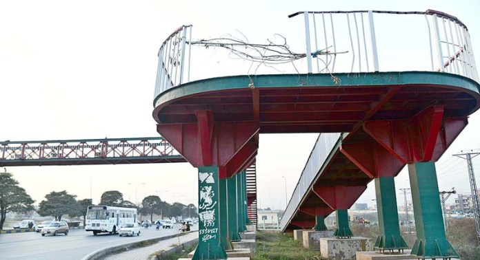 A view of a broken fence of pedestrian bridge at Khanna Pul on Expressway may cause any mishap and needs the attention of the concerned authorities