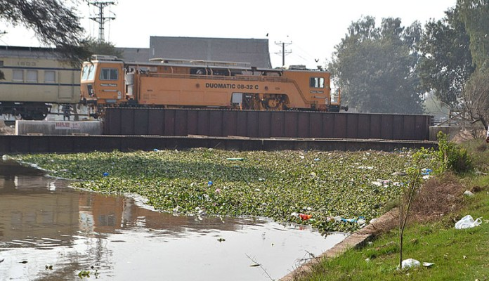 A view of garbage accumulated in Nou Bahar Canal making the canal water polluted, creating environmental problem and needs attention of the concerned authorities
