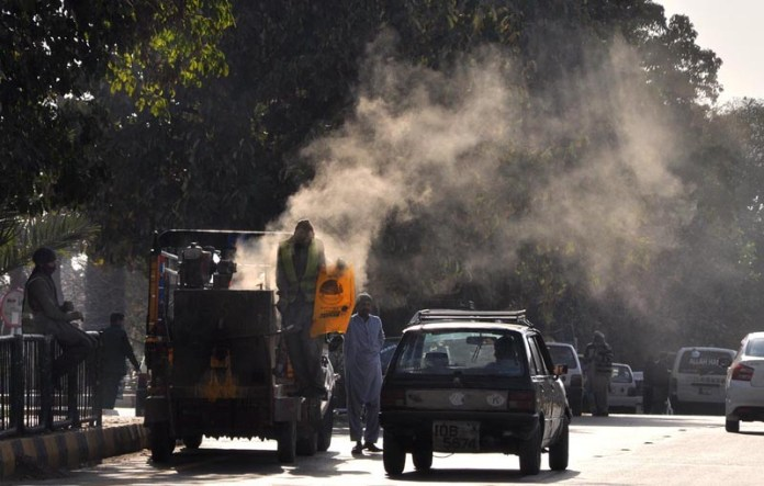 A view of smoke spreading from a road maintenance machine by CDA near Aabpara Market