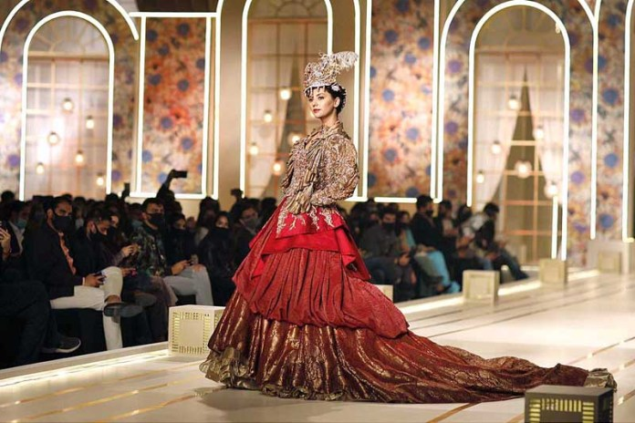 A model walks on the ramp during last day of the Hum Bridal Couture Week on late Saturday Night