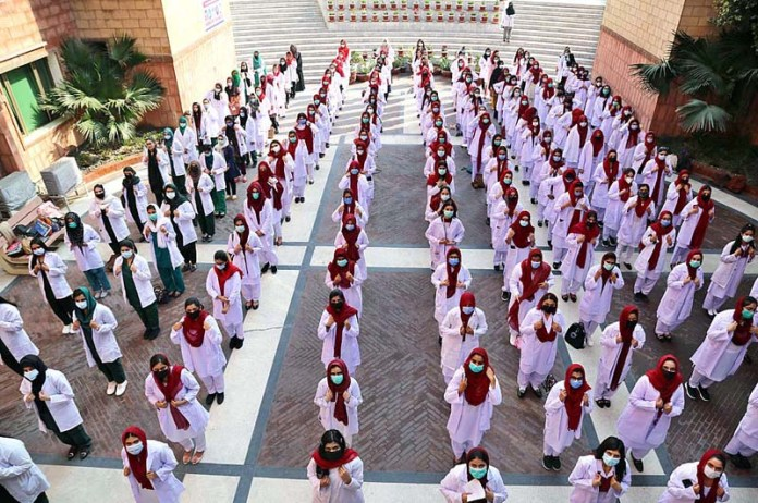 Students of first year of MBBS and BDS are participating in White-Coat Receiving Ceremony at University Medical & Dental College (UMDC) The University of Faisalabad (TUF)