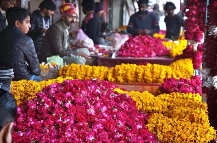 Vendors displaying flower garlands, baskets and bouquets to attract the customers at Flower Market