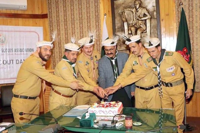 Minister for Information and Planning & Development Gilgit-Baltistan Fatullah Kahn cutting cake with Scouts Boys during Scouts Day celebration
