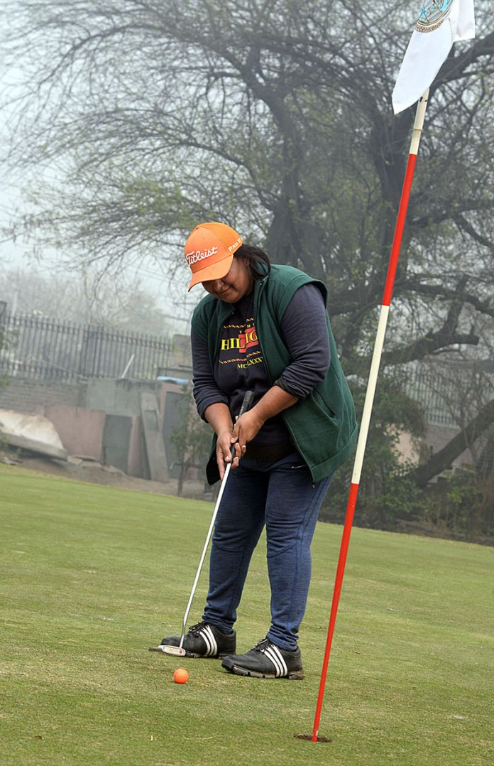 Players in action during Third Chairman WAPDA Golf Tournament at Gymkhana Club