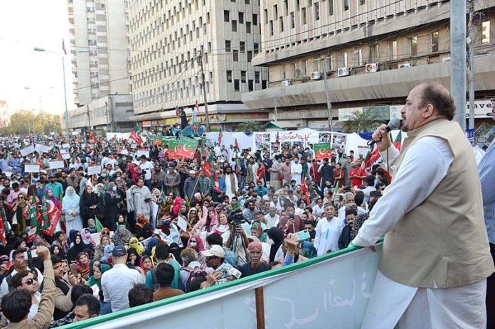 Member Provincial Assembly Firdous Shamim Naqvi addressing workers and supporters of PTI during protest demonstration for the release of opposition leader in Sindh assembly Haleem Adil Sheikh in front of Press Club