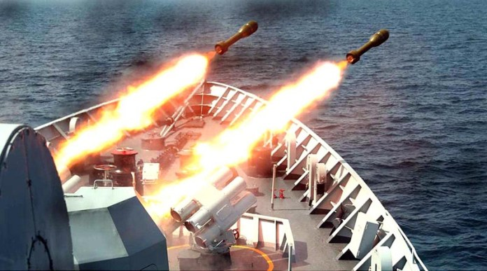 A Pakistan Navy ship demonstrating live weapon firing during sea phase of Multinational Maritime Exercise AMAN 21