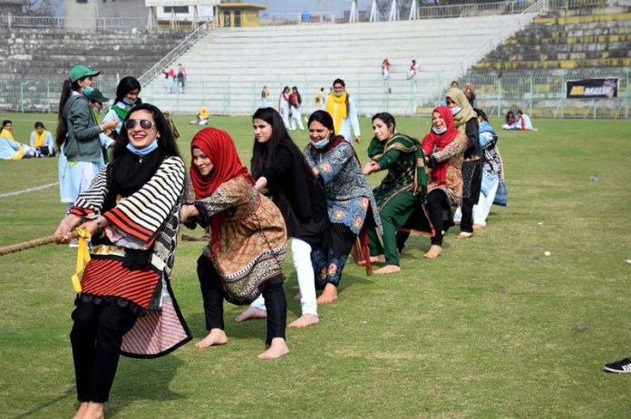 Teachers of Shadab Girls College participating in tug-of-war competition during sports event at Jinnah Stadium