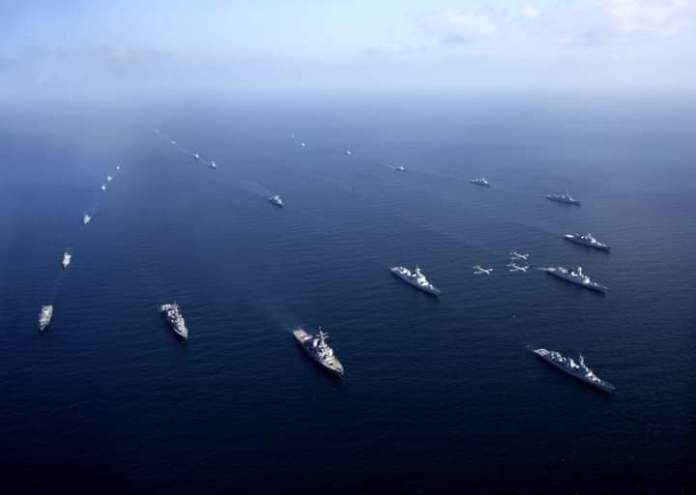 Ships of participating countries in AMAN formation during International Fleet Review of Multinational Exercise AMAN-21